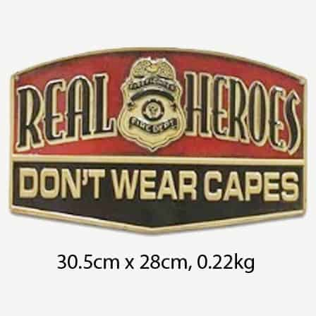 Vintage Real Heroes Don't Wear Capes Tin Sign
